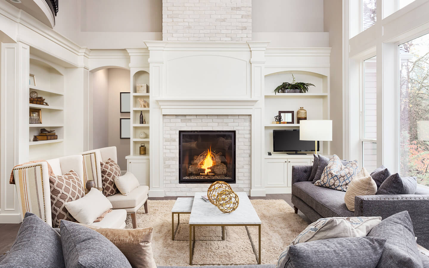 Comfy living room with white bricked fireplace and modern rusty looking furniture